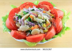 Salad from Boiled Huge Lima Beans mixed with Seasonings and dressed with Olive Oil, Balsamic Vinegar, Key Lime Juice, served in Porcelain Bowl over Lettuce Leaves and decorated with Tomatoes. #Food #Stockphoto #Photography #Salad #Vegetables #Recipes