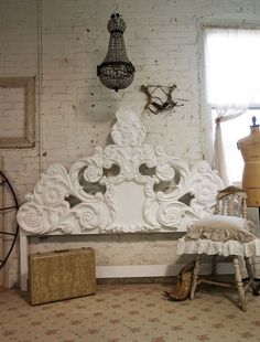 beautiful headboard.   Would look gorgeous in a black and white bedroom!