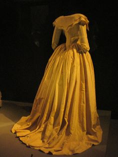 This is an example of a 1780s Redingote. These were long coat like garments that women wore over there dresses during the time of the French Revolution.
