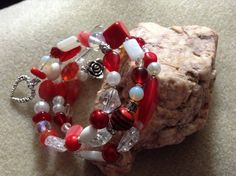 Memory wire red and white beaded bracelet with charms £5.00