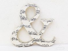 Dishfunctional Designs: Bookish: Upcycled & Repurposed Books and Pages // sheet music ampersand <3
