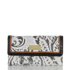 Our lovely checkbook wallet in new lady damask patterned leather. #brahmin #summer #blackandwhite
