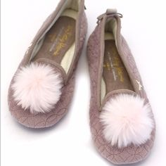 Slip on ballerina style slippers with poof toe Slip on ballerina style slippers with faux fur poof detail on the toe. Small bow with Crystal button on the back.  Pretty maybe color with soft pink poof.  Very cushioned bottoms and rubber soles that allow for indoor/outdoor use. These also make GREAT gifts. Easy, comfy, cute. Shoes Slippers