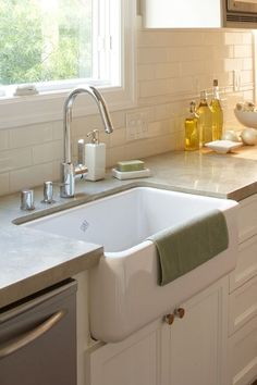 farmhouse sink with concrete countertop