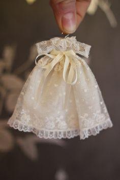 Miniature christening gown by Artesanos Felipe de Royo