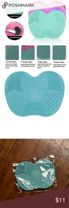 NEW Makeup Brush Cleansing Mat 100% brand new still in package! Excellent way to clean your makeup brushes without ruining or damaging them. Make an offer if you're interested! Don't forget about my bundle discount :) Makeup Brushes & Tools
