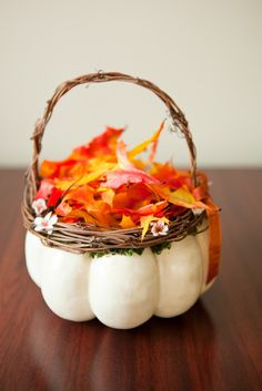 Flower girl's pumpkin basket. Instead of flowers, use leaves for a fall themed wedding. Debbie Wong Photography, Calgary wedding photography, www.debbiewongphotography.com