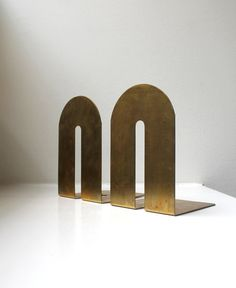 Heres a gorgeous pair of modernist, brass bookends. Excellent vintage condition, they are very substantial cast brass in as found condition
