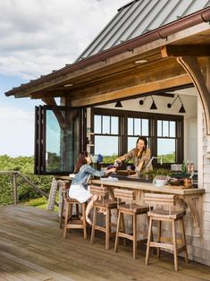 Kitchen and Deck Window. Pass-through window. To blur the line between the kitchen and the deck, architect Jeremiah installed a NanaWall folding window and designed a wood bar that's an extension of the kitchen counters. Visitors can perch on the custom-b