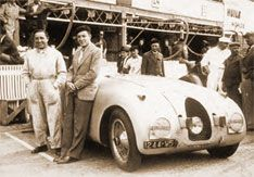 bugatti.com -  Bugatti work driver Pierre Veyron (left) in front of his winning car, the T 57C Tank at the race in Le Mans 1939