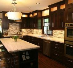Like the cabinet fronts and molding at ceiling.  Not so hot on the lighted cabinets. Mission Style Solid Oak Kitchen Cabinets