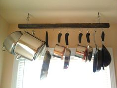 DIY pot rack {hang in place of microwave above stove. mount old yardstick to front} Microwave Above Stove, Pot Rack Hanging, Pot Racks, Little Kitchen, Cool Kitchens, Track Lighting, Kitchen Remodel, Robin, Kitchen Ideas