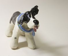 Hand sculpted Ceramic Dog to Steal your Heart by CedarPocket