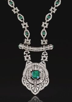 IMPORTANT EMERALD AND DIAMOND SAUTOIR, FRENCH, CIRCA 1930.    Designed as a series of open work lozenge and stylised circular links set with diamonds, the former accented with cabochon emeralds, suspending an open work pendant of Persian design, centring on an emerald, accented with diamonds, supported on a curved bar with emerald terminals, mounted in platinum.     French assay marks, separates into four bracelets and a brooch, brooch fitting.