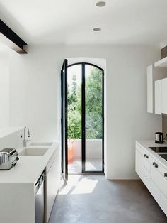 steel windows, concrete floors, white kitchen