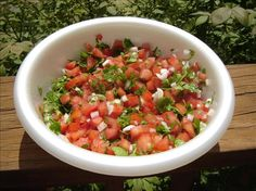 Pico de Gallo from Food.com: I literally live on this in the summer when tomatoes are garden-ripe! I prefer this to cooked salsa, and I really load up on the cilantro. Of course, you can adjust the heat and any other ingredient as you wish, but this is the basic recipe. Serve with your favorite tortilla chips. Hope you enjoy it as much as I do!