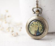 Peacock pocket watch necklace