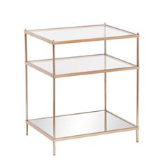 Bring the roaring '20s to life with this opulently simple side table. The minimalist architecture contrasts with the luxurious, metallic gold frame, high shine mirrored shelf, and sleek glass tabletop
