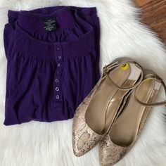 Purple top Light material top, in a dark purple. Bands on the sleeves and bottom. Buttons in the front. Perfect condition. Open to offers. No trades. Faded Glory Tops