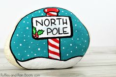 Learn to make this fun North Pole Christmas painted rock to display, give, or hide as a kindness rock this season. Click through to make this fun, bright rock painting idea. Easy Canvas Painting, Rock Painting Ideas Easy, Pebble Painting, Pebble Art, Stone Painting, Rock Painting Patterns, Rock Painting Designs, Posca Art, Painted Rocks Craft