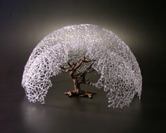 When he created the sculpture Braeburn (pictured below), glass artist Micah Evans drew upon inspiration from an apple tree in the back yard of the house he grew up in. Description from dailyartmuse.com. I searched for this on bing.com/images