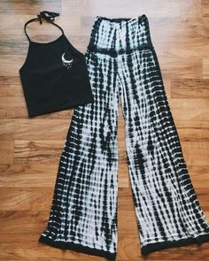 Show off your hippie spirit with these Tie Dye Palazzo Pants! These pants feature a black and white tie dye design | Shop More Hippie Clothing at Livin' Freely