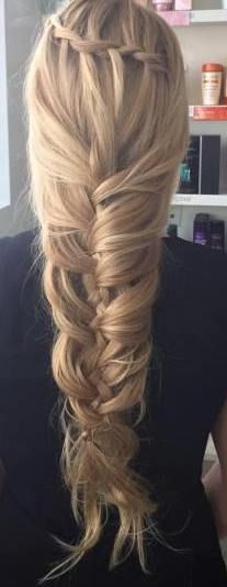 Loose mermaid braid for long hair.