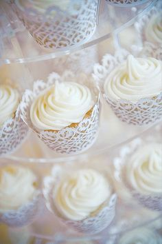 Filigree cupcake wrappers for wedding cupcakes. You mentioned you wanted simple cupcakes - this is cute because the wrapper is the decorative piece! White Wedding Cupcakes, Lace Cupcakes, White Cupcakes, Wedding Desserts, Mini Cupcakes, Cupcake Cakes, Wedding White, Wedding Cup Cakes, Pretty Cupcakes