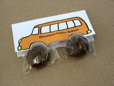 Use small snack size baggie and add 2 mini chocolate donuts (store bought) for tires. Create an image of a school bus or a car/truck. You'll be folding this paper in half and tucking in baggie, so remember this when setting up document. Print out, cut out tire openings and fold in half. Staple paper buses to bags.
