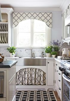 Open Storage and sink skirt add balance and beauty to the kitchen in designer Colette van den Thillart's home. Photo:  Photo: Virginia MacDonald