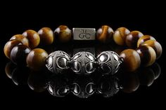 Designer Beaded Bracelet for men made with 12mm .925 sterling silver beads and 12mm yellow brown Tiger Eye stones, part of our premium silver collection