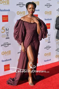 #LupitaNyongo wore an off-the-shoulder #eveningdress with a high slit at the #2019NAACP Image Awards.
