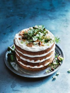 This four-layer cake spiced with almond and orange blossom and smothered in vanilla ricotta icing is an impressive dessert for your next celebration.