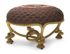 A FRENCH GILTWOOD STOOL  CIRCA 1900, AFTER THE MODEL BY FOURNIER, PROBABLY SUPPLIED BY PIERRE DELBEE OF MAISON JANSEN The circular buttoned seat centred by a petit-point roundel, above rope-carved rails, with similarly carved knotted legs and stretchers, with sunk castors