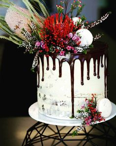 Four layer naked chocolate cake vanilla buttercream salted drip cake adorned with australian natives junglespirit Images
