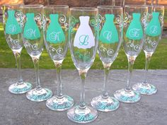 Bridesmaid champagne glasses, 7 Personalized dress flutes for bridesmaids. Tiffany blue and white, mint or you pick color. $84.00, via Etsy.
