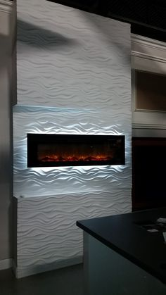 3D accent wall at Improve Canada mall.  Elegant wave design. #TalissaDecor's showroom (Unit #145). Come to visit us at 7250 Keele St. The wall made of real plaster panels - this is why there are no seams.  Once the panels were glued to the wall - the joints were filled with drywall compound and sanded smooth.  For more accent wall ideas - visit our website at www.talissadecor.com #accentwall #3Dwall #3Dwallpanels #wavypanels #texturedwalls #plasterpanels #homeimprovement