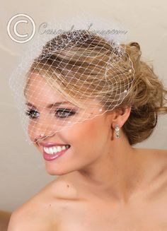 http://cassandralynne.com/collections/birdcage-veils/products/bridal-visor-veil-with-pearl-accents