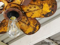 I love this rusty old propeller that's been turned into a hanging light. from Junk4Joy. Very Clever!