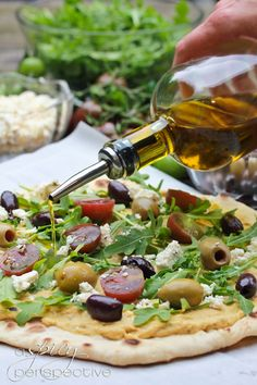 Grilled Pizza Layered with Hummus, Fresh Veggies, Olives and Feta