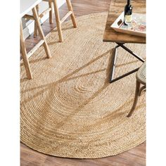This lovely, reversible, braided jute fiber rug adds contemporary elegance to your home space. Braided fiber lengths are stitched into the oval rug shape. Hand-spun jute fibers are naturally silky, highly durable and are a fully renewable resource.