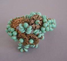 Haskell Hess aqua glass beads coil bracelet