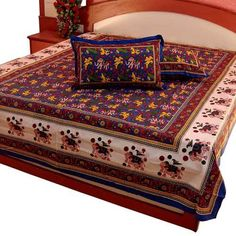 Jaipuri Pure Cotton 3 Piece Double Bed sheet set contains: A. One Double Bed Sheet in traditional Sanganeri print of Jaipur. This admiring bed sheet is embellished with multi-colour floral motifs on blue base. It is graced with latest Sanganeri design on border to give an ethnic yet modern glance.The bed sheet set is in bright and traditional Rajasthani hand-Block motif prints to enhance your decor
