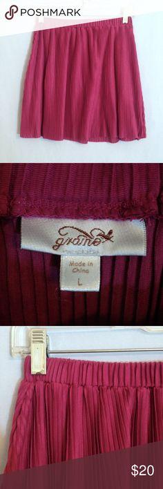 "Graine Dusty Pink Pleated Mini Skirt Graine dusty pink/purple pleated mini skirt. Small vertical pleats all around the circle skirt. Elastic waist, Size L (Junior), 100% polyester.  Measurements: waist 13"", hem width 30"", length waist to hem 16"". Cute and flirty! Graine Skirts Mini"