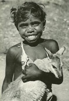Aboriginal boy with a Kangaroo for a pet, Photo shared by the Australia National Geographic | October 1955.   v@e.