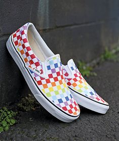 "Step up your shoe game with a brightly colored take on one of the most famous shoes in skate-wear, with the Vans Slip-On Rainbow Checkerboard Skate Shoes. Featuring a vulcanized construction for board feel and Vans classic ""waffle tread"" for traction, Vans Outfit, Rainbow Vans, White Rainbow, Rainbow Pride, Custom Vans Shoes, Custom Made Vans, Custom Slip On Vans, Vans Shoes For Sale, Customised Vans"