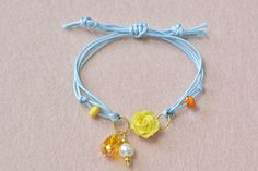 Now I'm showing you the final look of this spring fashion waxed cord bracelet with polymer clay flower!