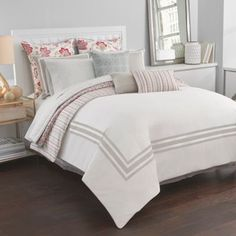 Soft and feminine, the Sarasota Comforter Set from Boutique Living brings an understated elegance to any space with its clean framed detail. Reversing to a subtle striped pattern in tones of red, sage and gold, the set is complete with matching shams.