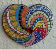"Latest mosaic heart is called ""Heart-Spin"" & is available for purchase in my Etsy shop here:  https://www.etsy.com/listing/237967547/heart-spin-colorful-boho-mosaic-art?ref=shop_home_active_3"