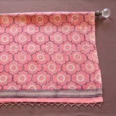 India Rose ~ Sheer Pink Floral Decorative Beaded Window Valance by Saffron Marigold. $32.99. Floral blossoms in an Indian inspired grape trellis print patterned across a salmon pink ground. Printed on cotton voile with wonderful light filtering properties. Panels sold separately.. Hand wash, gentle cycle, cold water, mild detergent. Finished with a delicate hand beaded trim and a 3-inch rod pocket for easy hanging.. Hand printed using intricately carved wooden blocks.. ...
